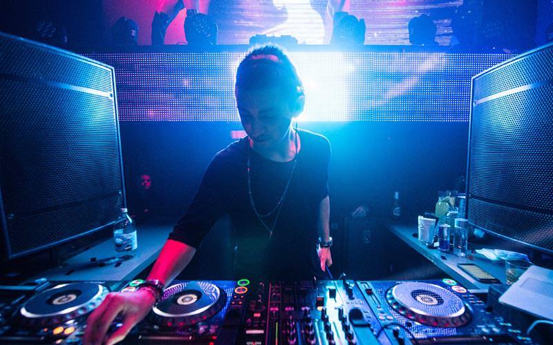 A DJ on the decks in a club