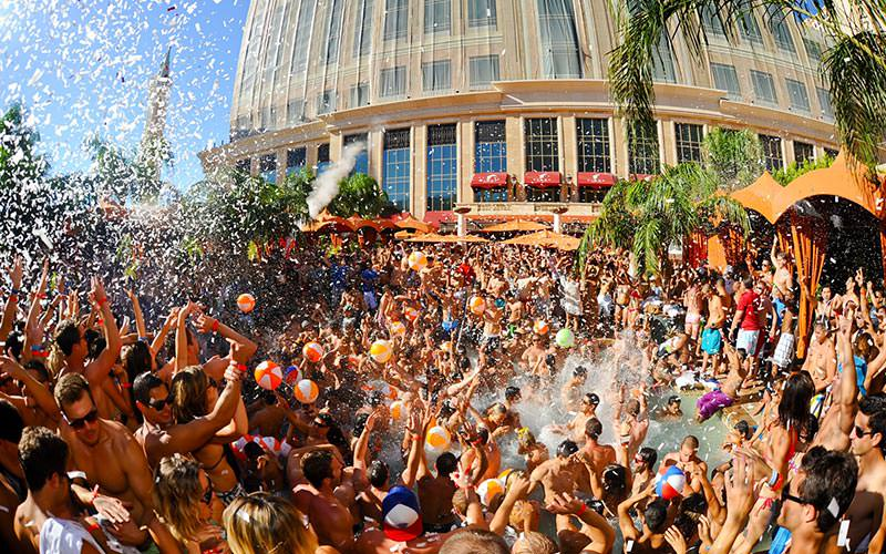 A pool party with lots of water splashing everywhere