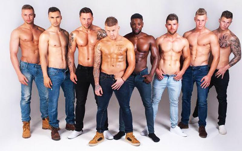 Some gorgeous men lined up with their tops off