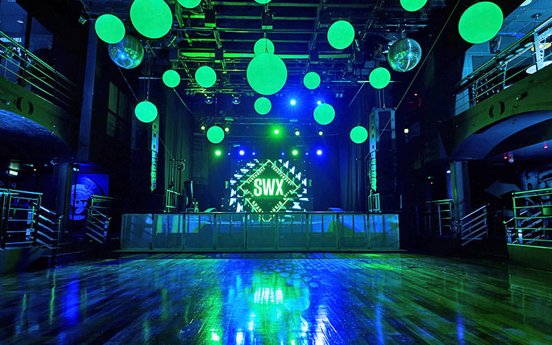 Green lights above the dance floor and stage area at SWX, Bristol