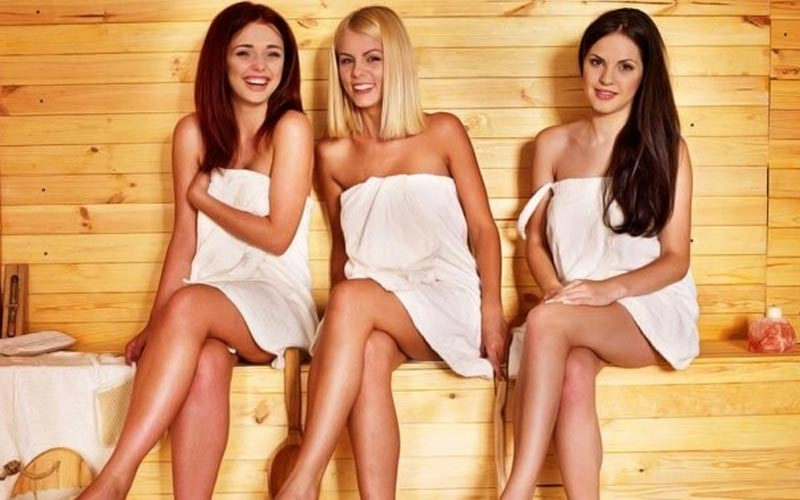 Three women in a spa, wearing towels