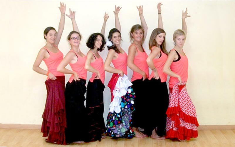 A group of women in flamenco dresses