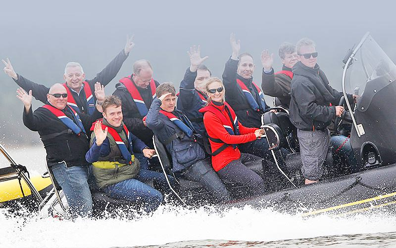 A group of people on a RIB boat
