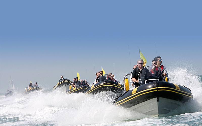 Six RIB boats travelling fast across the sea