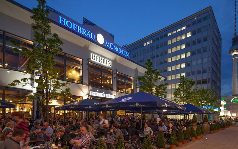 People sat in the outdoor beer garden at Hofbrauhaus, Berlin, at night