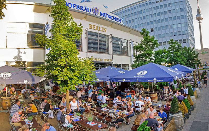 Crowds of people sat in the outdoor beer garden at the Hofbrauhaus, Berlin