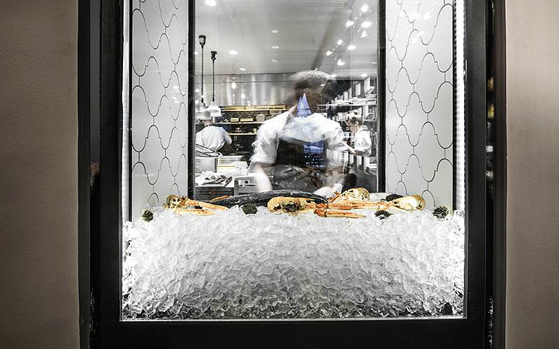 Seafood on ice in a glass box