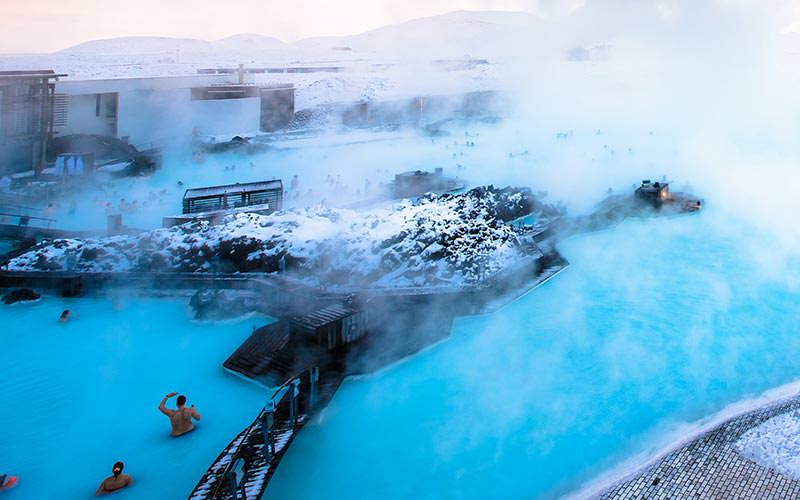 People in the Blue Lagoon with steam on top