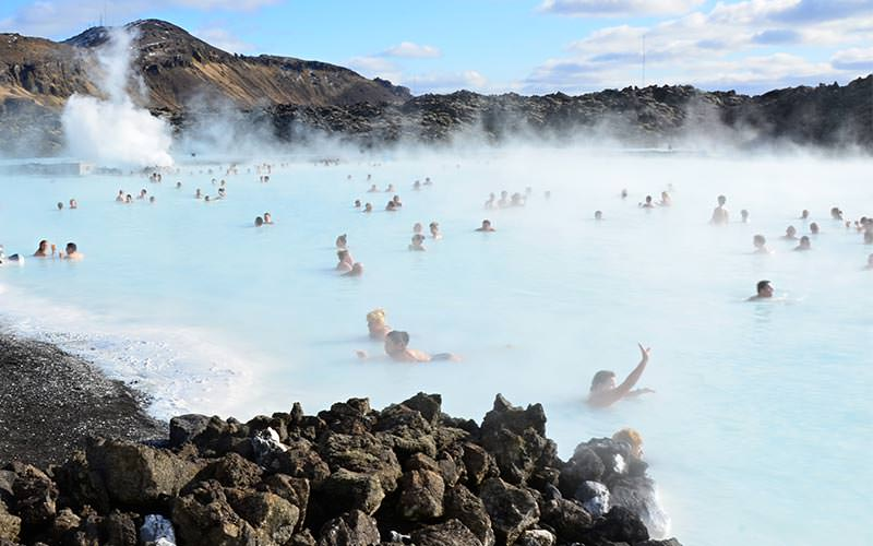 Steam on top of the Blue Lagoon, with people in it