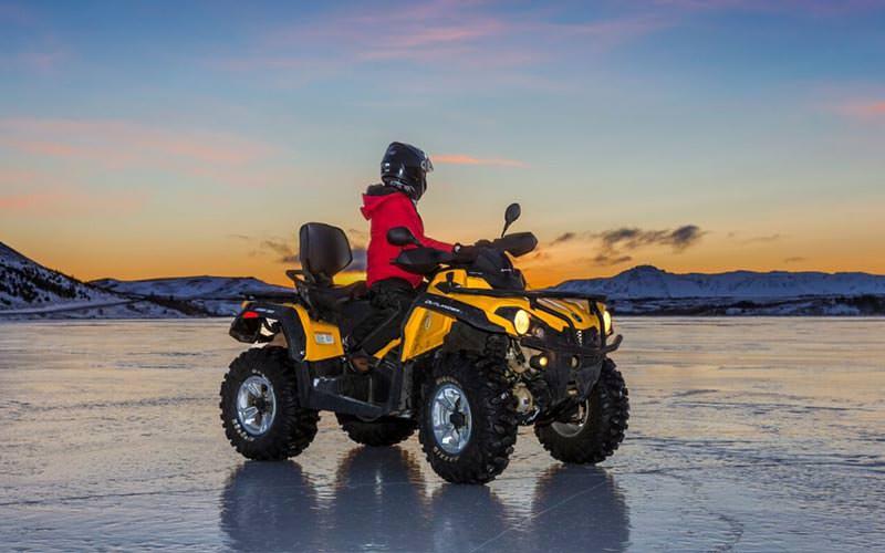 A man sat on a quad bike on ice