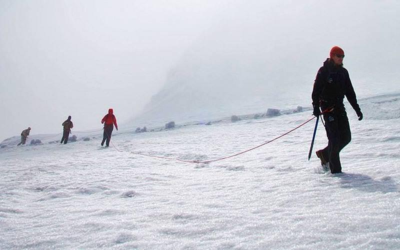 People walking on a glacier