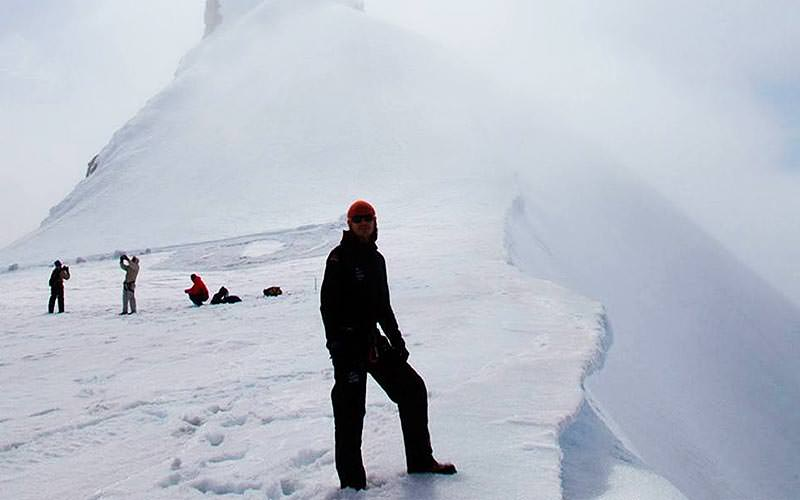 A man stood on the edge of a glacier