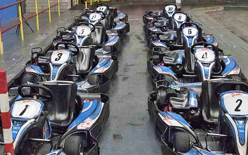 Two adjacent rows of five blue go karts