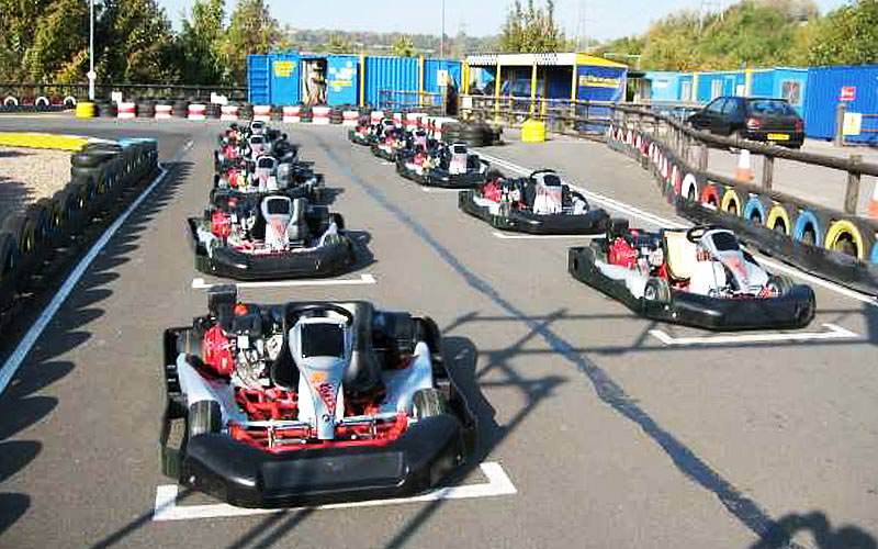 Karts in position on an outdoor track