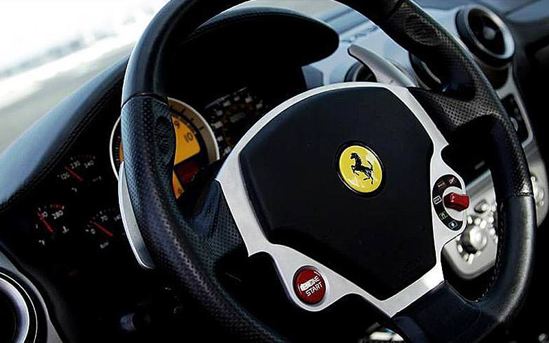 A close up of a Ferrari steering wheel