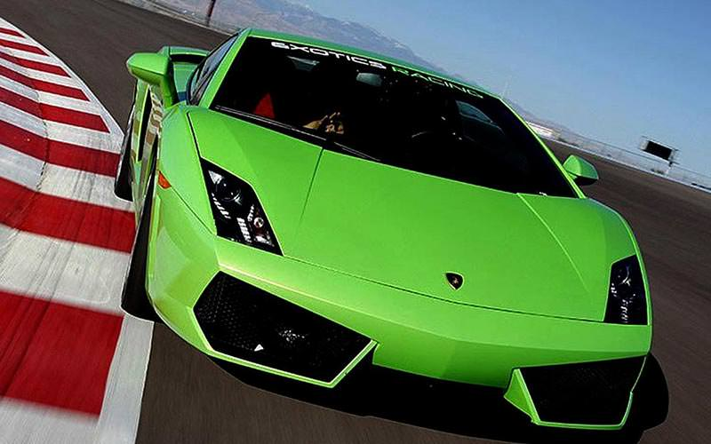 A close up of a green Lamborghini Gallardo on a racetrack