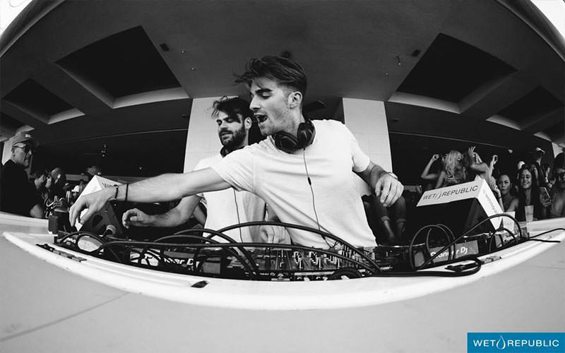 A black and white image of two DJs in the booth at Wet Republic