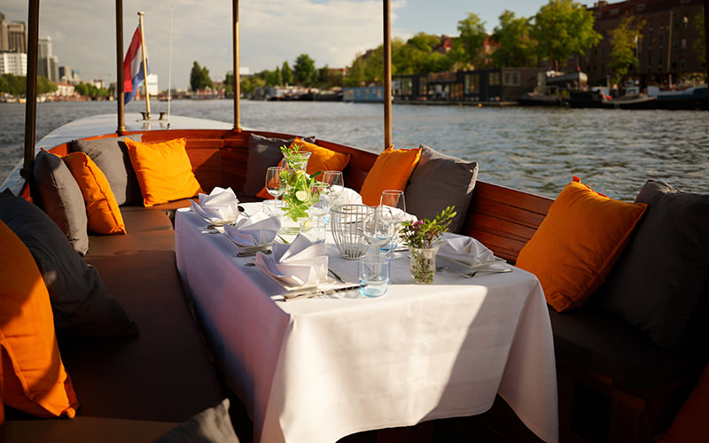 A table and seating area on a boat