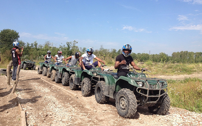 A group of people on quad bikes
