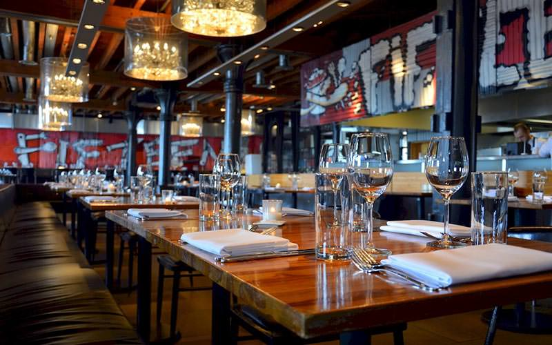 Tables and chairs set for dinner in Jamie Oliver's Fifteen restaurant, Amsterdam