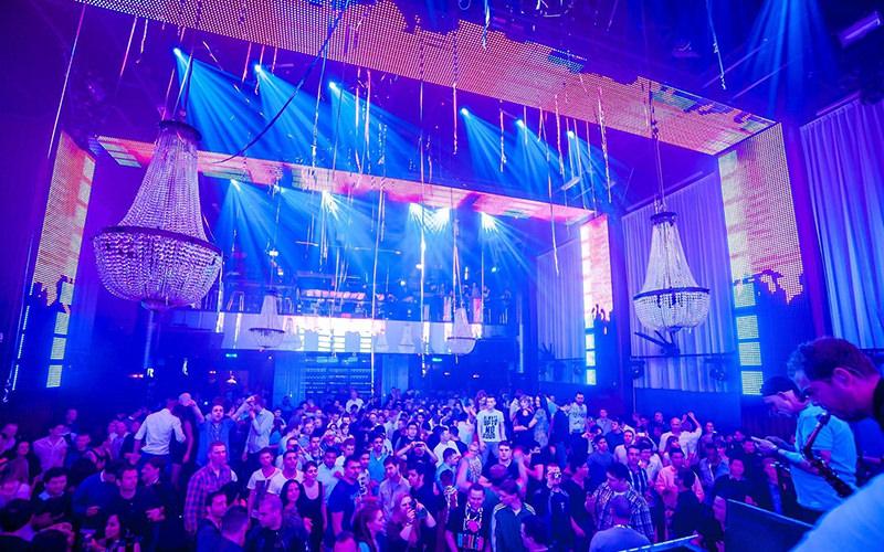 A nightclub with dark purple lighting