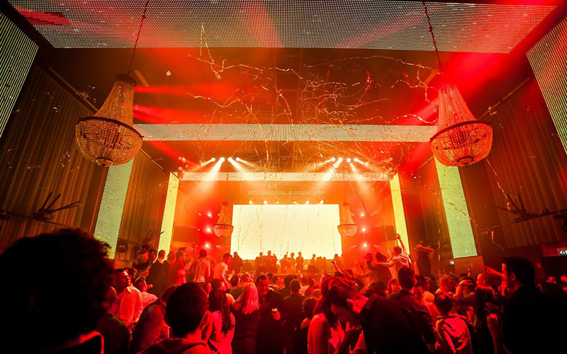 A nightclub with orange and red lighting