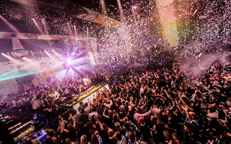 A large crowd dancing in a nightclub