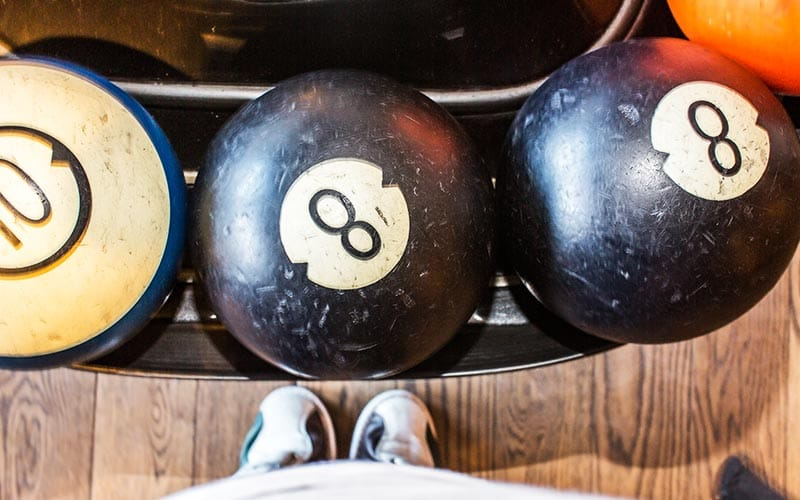 Bowling balls sitting, made to look like american pool balls