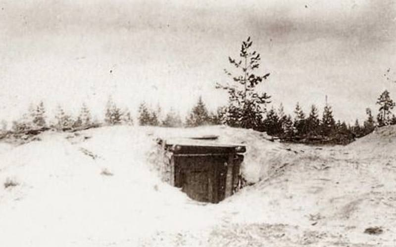 Black and white image of a bunker in the snow