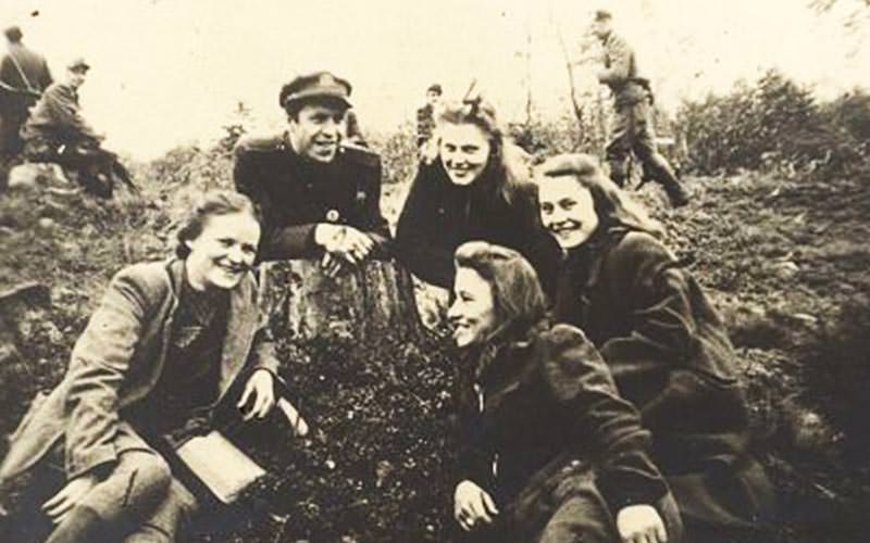 Black and white image of five women smiling
