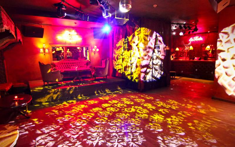 An empty dance floor, lit up with lights, at Pabo Latina