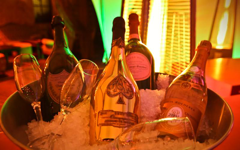 Champagne bottles and flutes in an ice bucket