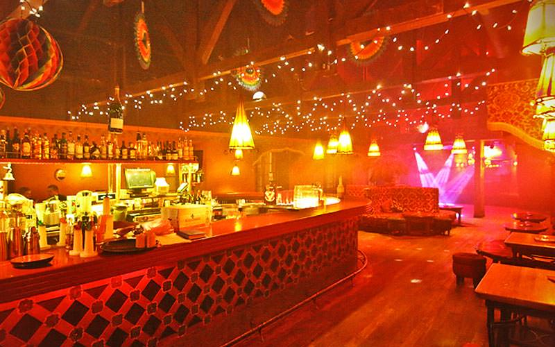 The bar and surrounding dance floor and seats at Pabo Latina