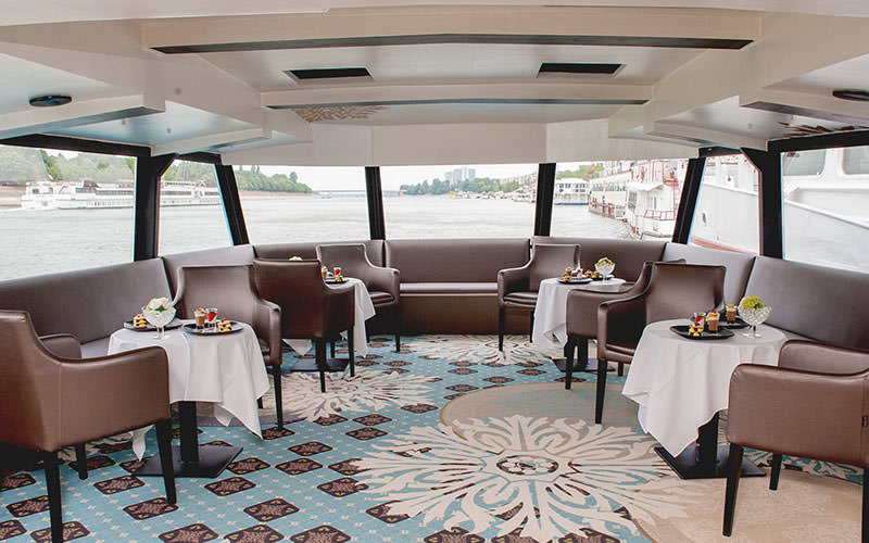 Some plush seats in the covered part of the boat