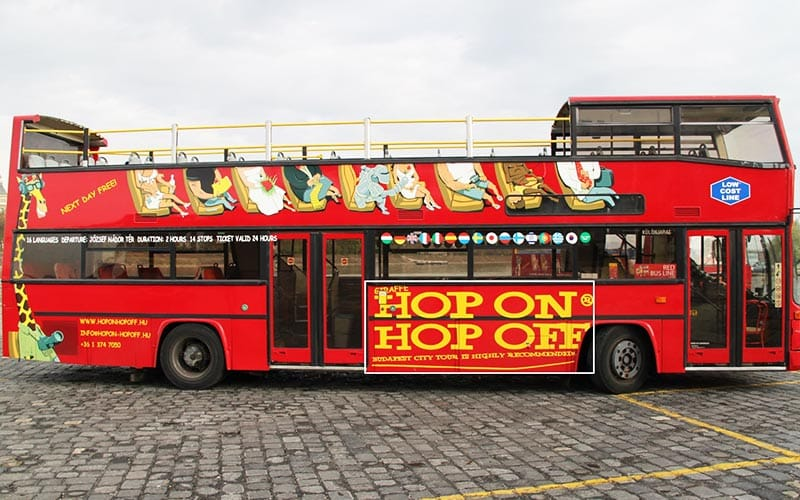 A red hop on, hop off bus in Budapest