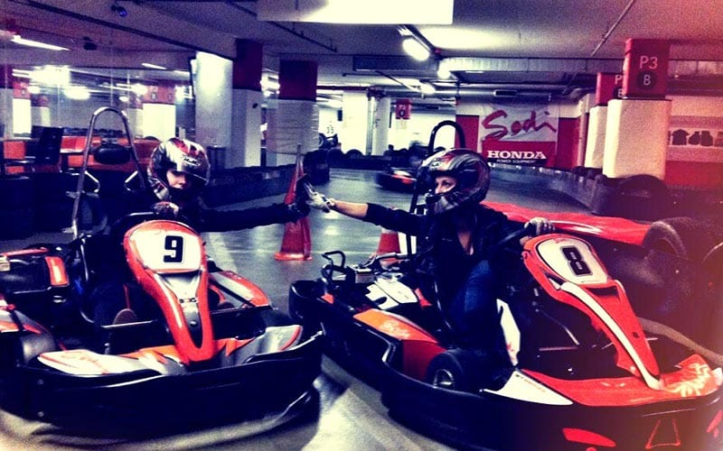 Some go karts in an indoor arena