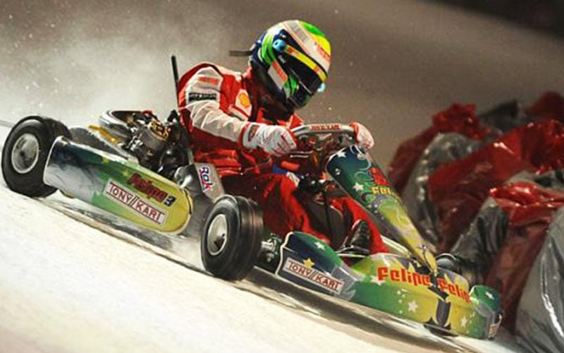 A man driving a green and red go kart