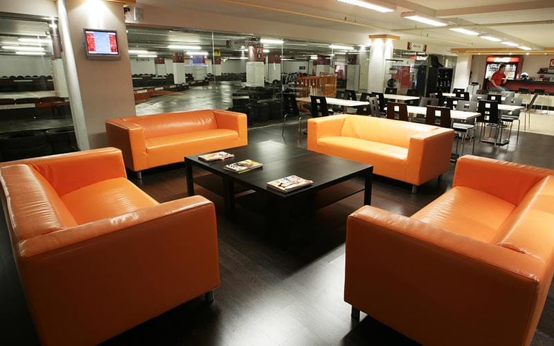 Some orange sofas in a sitting area