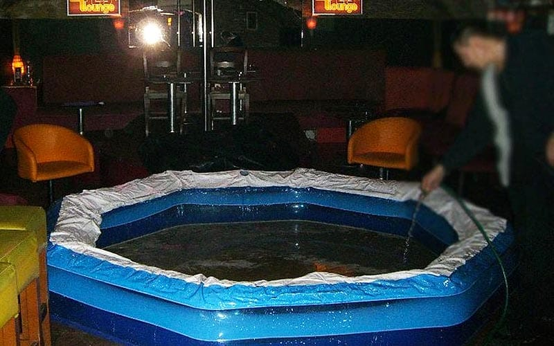 A paddling pool being filled with mud and water