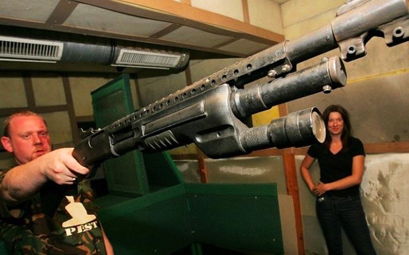 A man firing a gun in a shooting range