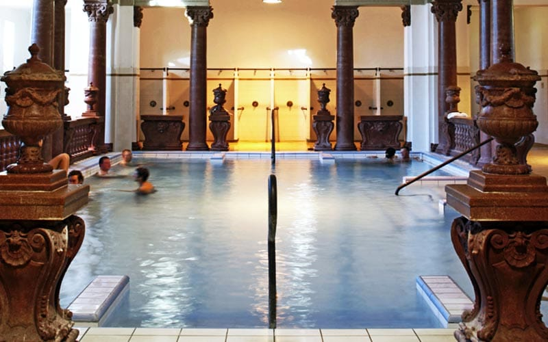 An indoor thermal pool with wooden ornaments in Szechenyi Thermal Baths