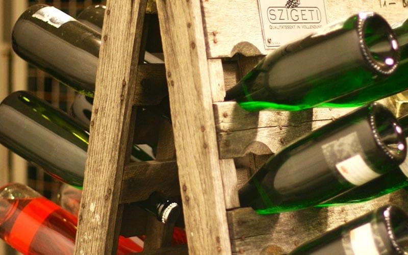 Loads of bottles of wine in a wooden wine rack