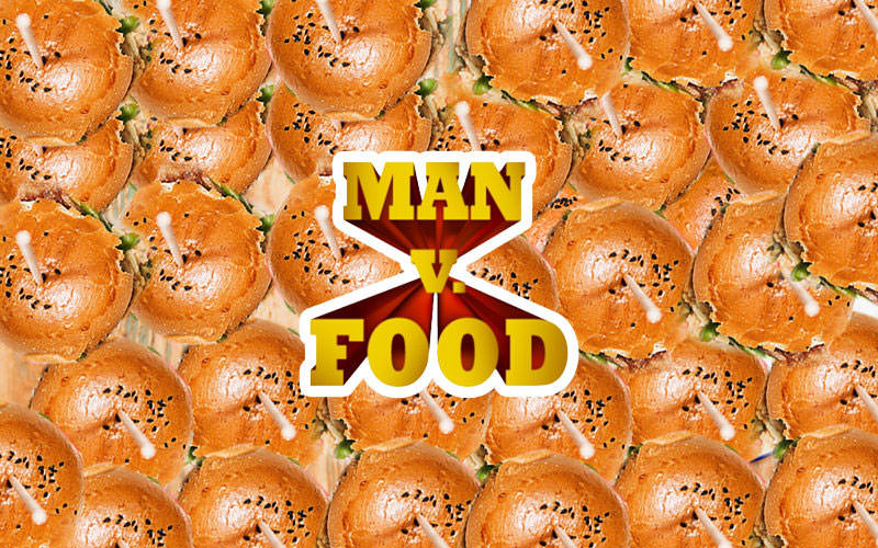 Lots of burgers from above repeated for the background with Man Vs Food logo on front