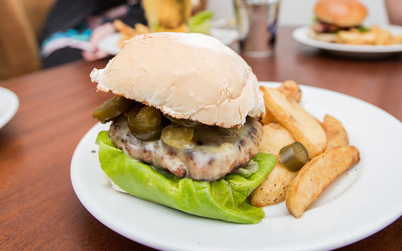 burger with lots of jalapenos and cheese