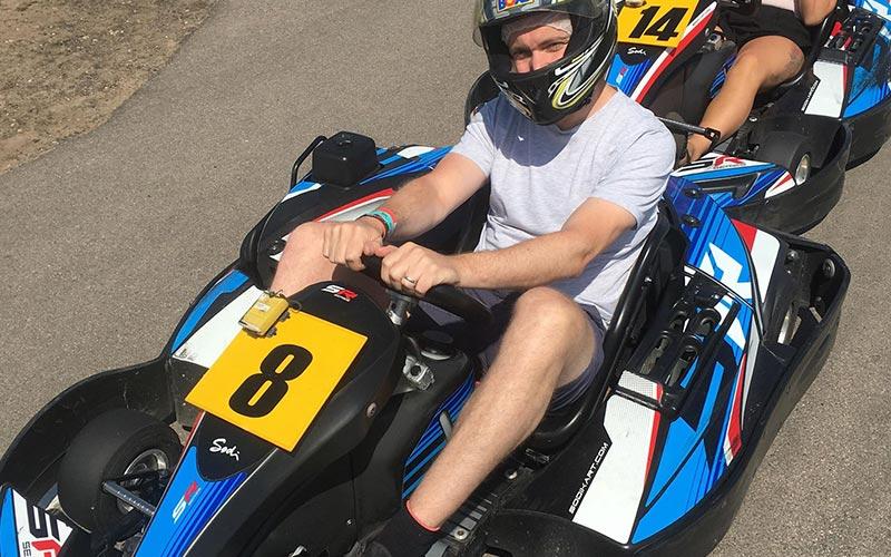 A man sitting in a go kart