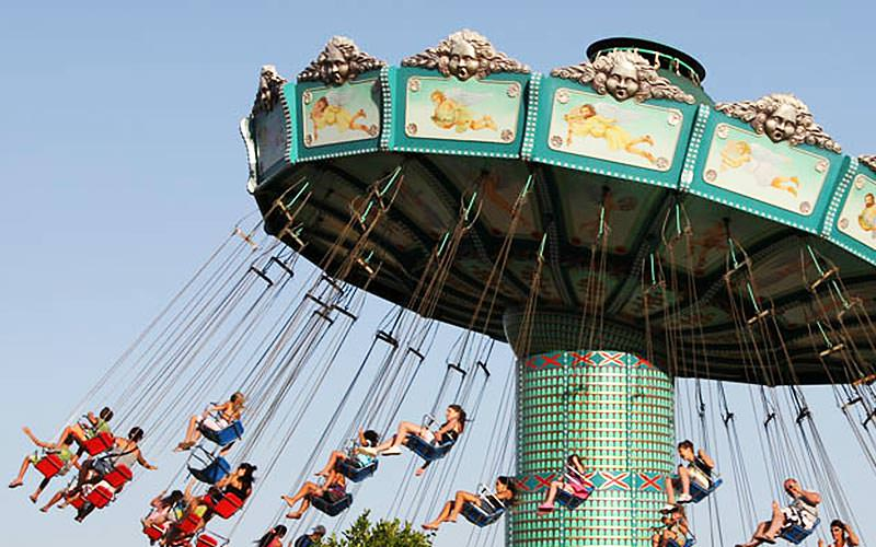 People sat in swings on a ride