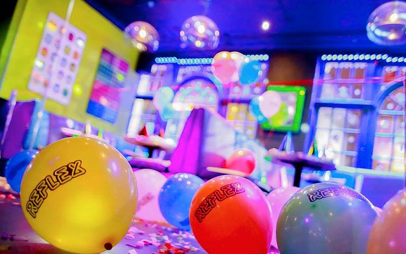 Balloons on the floor of a nightclub