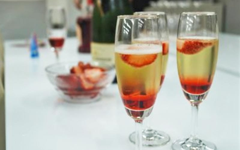 Three glasses of champagne with strawberries in