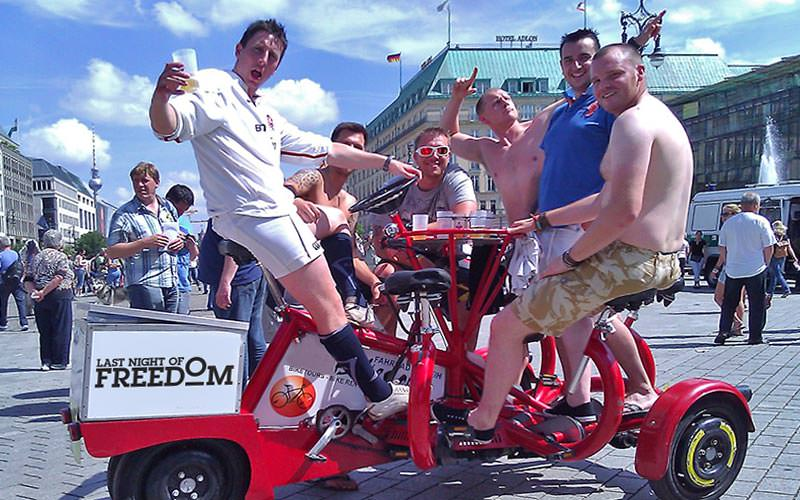Group of men sat on a conference bike in Berlin