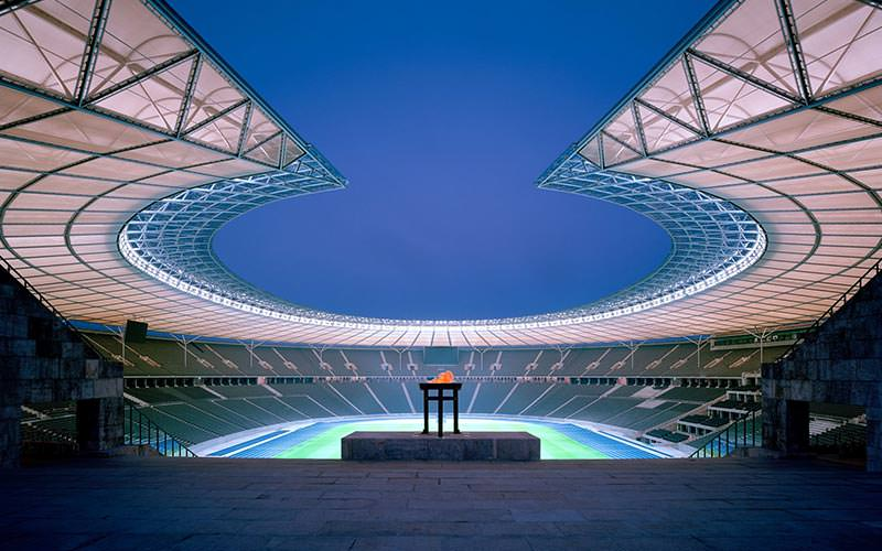 The Olympic 'flame' at the Olympic Stadium, Berlin, with the seats and pitch in the background